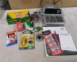 lot of misc. items including calculator, recipe drawer, crayons, stapler and time snapz watch