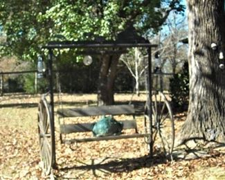 Custom made outdoor swing.  Made to look like old time buggy.  Cute oversize frog is taking a ride! :)