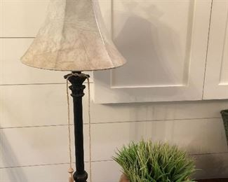 $22 / Tall, bronze candlestick lamp with tassels and smooth, leather look shade.