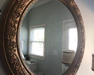 $125/ Carolina round decorative mirror