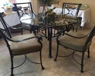 Glass Top Table with Iron Base, look at the details, Hooves on bottom of Table and Chairs, See Back of Chairs, Really Nice...