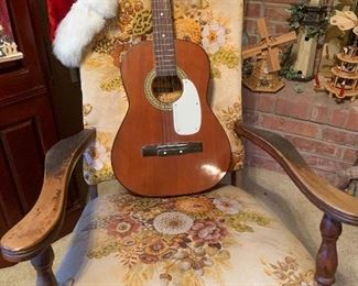 Guitar on antique arm chair