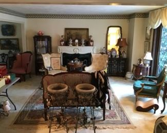 Living Room filled with global treasures and rugs. Chinese Foo Dogs $195, Brass Fireplace Screen $95, Pair of Vintage Chairs $325 / pair, Gilt Antique Chair $895