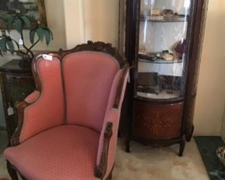 Antique Carved Mahogany and Upholstered Chair $395, Curio Cabinet $850