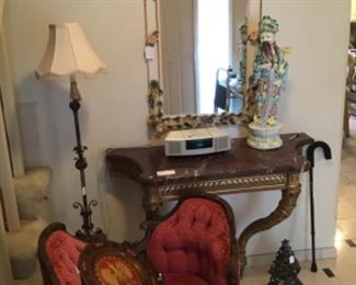 Vintage Tole Mirror $395, Antique Marble Top Console Table $1,250, Ceramic Chinese Figure Made In Italy $95
