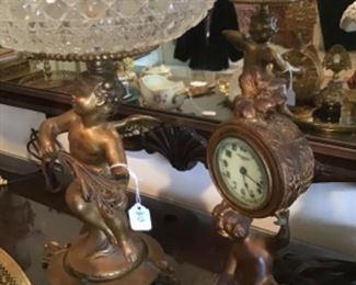 Spelter Cherubs as a footed bowl and table top clock