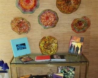 Handblown glass wall art with books on glass blowing, art and Chihuly.