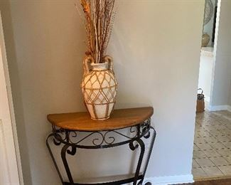 half moon side table; vase
