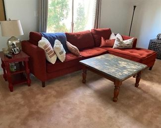 sectional sofa; end table; square rustic coffee table