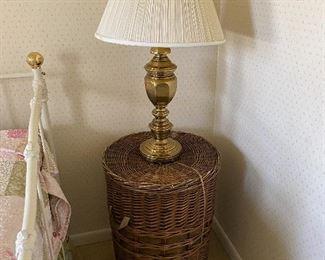 wicker storage table; brass lamp