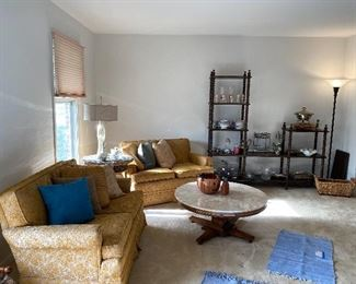 Vintage loveseats; marble top coffee table; vintage shelving unit