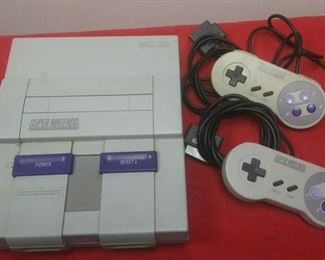 https://www.ebay.com/itm/124450462797GN3087 USED VINTAGE SUPER NINTENDO GAME CONSOLE WITH 2 CONTROLLERS  Auction