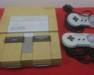 https://www.ebay.com/itm/124450457569GN3088 USED VINTAGE SUPER NINTENDO GAME CONSOLE WITH 2 CONTROLLERS  Auction