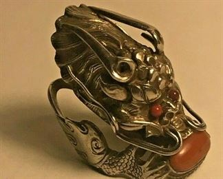 https://www.ebay.com/itm/124426450275	WL141 VINTAGE UNMARKED STERLING SILVER DRAGON RING WITH RED STONE		 Buy-it-Now 	 $200.00