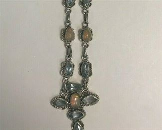 https://www.ebay.com/itm/124401623714	WL192 STERLING SILVER NECKLACE WITH OPALS AND LIGHT BLUE GEMS		 Buy-it-Now 	 $25.00