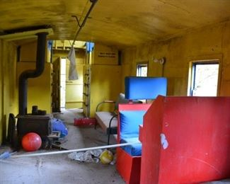 inside blue caboose (stove sold separately)
