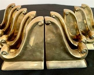 """$28/PAIR. Five sets of brass scroll bookends. Measures 6"""" tall."""