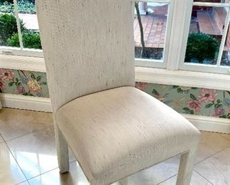 $500 for the SET of 8 Custom upholstered dining chairs. Chairs are off-white with small flecks of light blue, pink and purple. Great condition!
