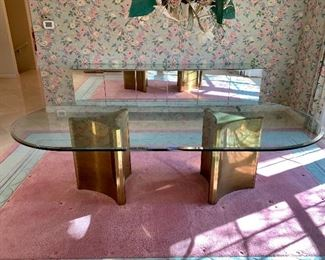$3200. Gorgeous, modern, oval, glass top dinning table with brass pedestals. Table measures 100x48x28. Seats 8 comfortably. This classic design still sells new for much more! :)