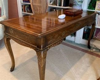 $400. One of 2020's items of the year! Solid wood writing desk by Drexel Heritage. Hand painted detail in the Chinoiserie genre. Desk measures 59x27x30. Perfectly scaled for smaller spaces.