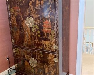 $650. Hand painted, Chinoiserie Cabinet with brass hardware. Cabinet measures 40Lx21Wx71H. Excellent condition. Both top and bottom door open with a bi-fold.