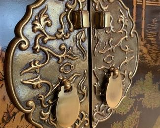 Close up picture of brass hardware on Chinoiserie Cabinet.