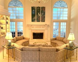 $3500. Custom, 6 piece circular sectional sofa, by Jack Brandt. Sofa is beige with accents of blue, mauve and light pink. Approximate measurements: left arm 70 inches, center arm 140 inches and right arm 70 inches. Excellent condition.