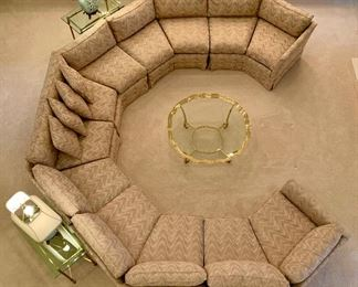 Alternate view! Custom, 6 piece circular sectional sofa, by Jack Brandt. Sofa is beige with accents of blue, mauve and light pink. Approximate measurements: left arm 70 inches, center arm 140 inches and right arm 70 inches. Excellent condition.