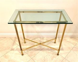 $250 for the PAIR of  beveled, glass top side tables. Base is made from lighweight brass.  Glass tops are heavy! Tables are 30Lx16Wx27H. Good condition. There is one teeny chip in the glass on each of the tables.