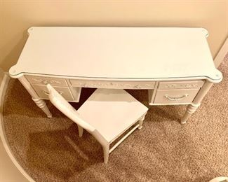$100. One of 2020's top products! Make this writing desk yours! Painted white, vintage, glass top, solid and functional. Chair included.
