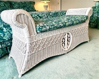 Close up of the white wicker sleigh bench.