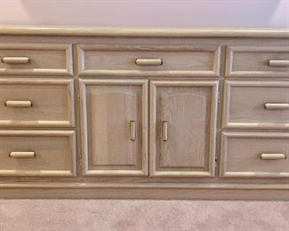 """$250. Full size vintage dresser by Broyhill. Color is a pale pink wood with brass accents on the hardware.  66"""" L."""