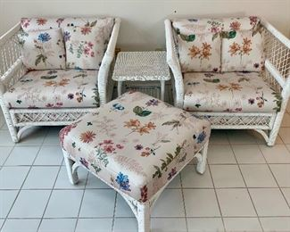 $300 for the FOUR piece white wicker seating set; 2 chairs, ottoman and cocktail table. Great condition! Custom upholstered.