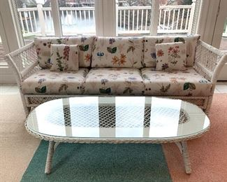 $300 for BOTH the white wicker sofa and coffee table. Both in GREAT condition!