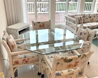 $250 for the SET; glass top table with white wicker base and 4 white wicker chairs on casters. All in great condition!