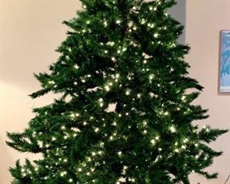 Prelit, artificial Christmas tree. Approx 9'. Good, clean condition. Has a few branches that do not light. $100