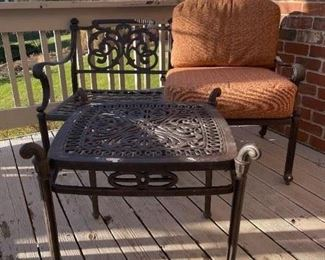 LOT 6601 Hanamint wrought iron outdoor patio loveseat with side table (terra cotta cushions included) (matches lot 6603, 6604 and 6605) $395