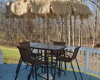 Pub height outdoor table with tiki umbrella