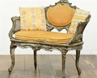 Vintage Cane-Back Sette With Gold Cushions And Pillows