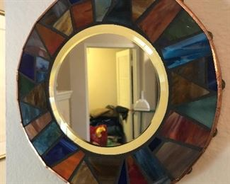 Beveled mirror with colored mosaic edging and copper accents...
