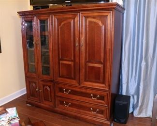 Cherry finish tv entertainment center. 56W x 20D x 59H