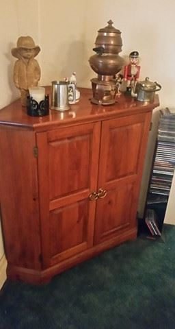 Corner cabinet with collectibles atop