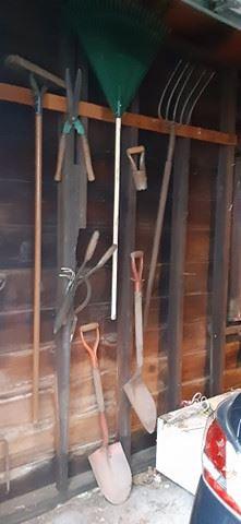Garage essentials (brooms, rakes, pitchfork, shovels, clippers)