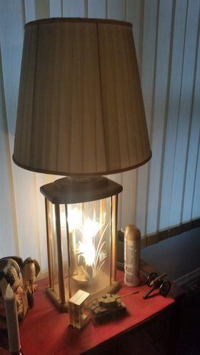 Lamp with illuminated base