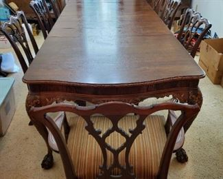 Antique 1920s red mahogany dining room table, chairs, buffet, and china cabinet custom made by Rhodes family (Rhodes furniture). Table shown with all removable leafs installed.