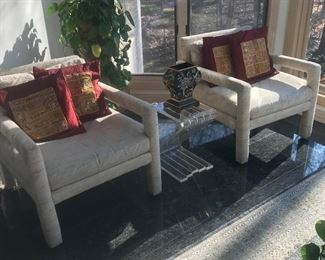 Pair of upholstered arm chairs and accent table