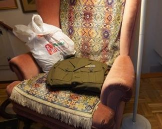 Wingback chair and old uniform
