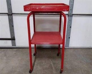 Red metal utility cart, cork top