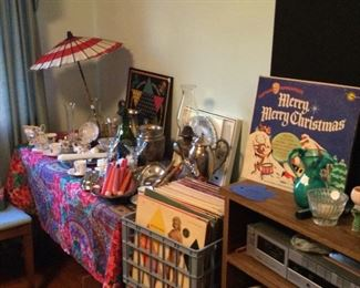 records, candles, cups and saucers