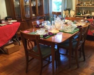 Drop leaf table with 3 additional leaves, and 6 chairs